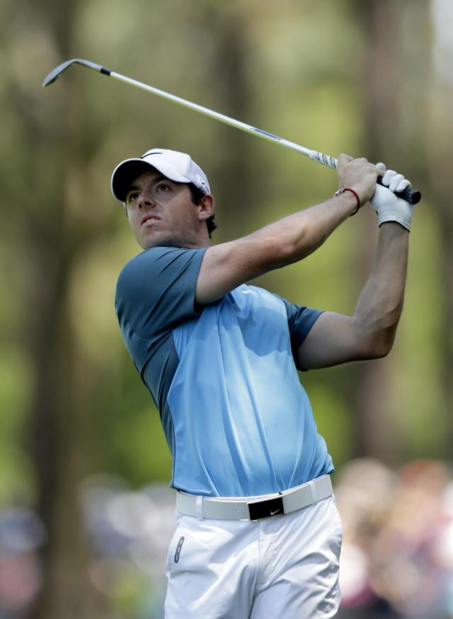 Rory McIlroy, of Ireland, watches his approach shot on the first hole during the final round of the Wells Fargo Championship golf tournament in Charlotte, N.C., Sunday, May 4, 2014. (AP Photo/Chuck Burton)