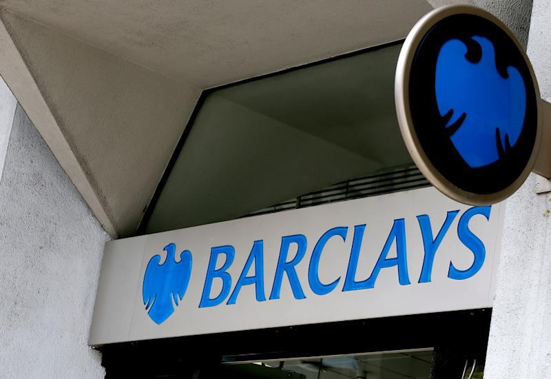 FILE - This July 29, 2015, file photo shows the sign on a branch of Barclays Bank in London. Barclays has agreed to pay $2 billion in civil penalties to the U.S. government to settle a lawsuit alleging that it was involved in a fraudulent scheme to sell residential mortgage-backed securities. The announcement was made Thursday, March 29, 2018, by the U.S. attorney's office in Brooklyn. (AP Photo/Kirsty Wigglesworth, File)
