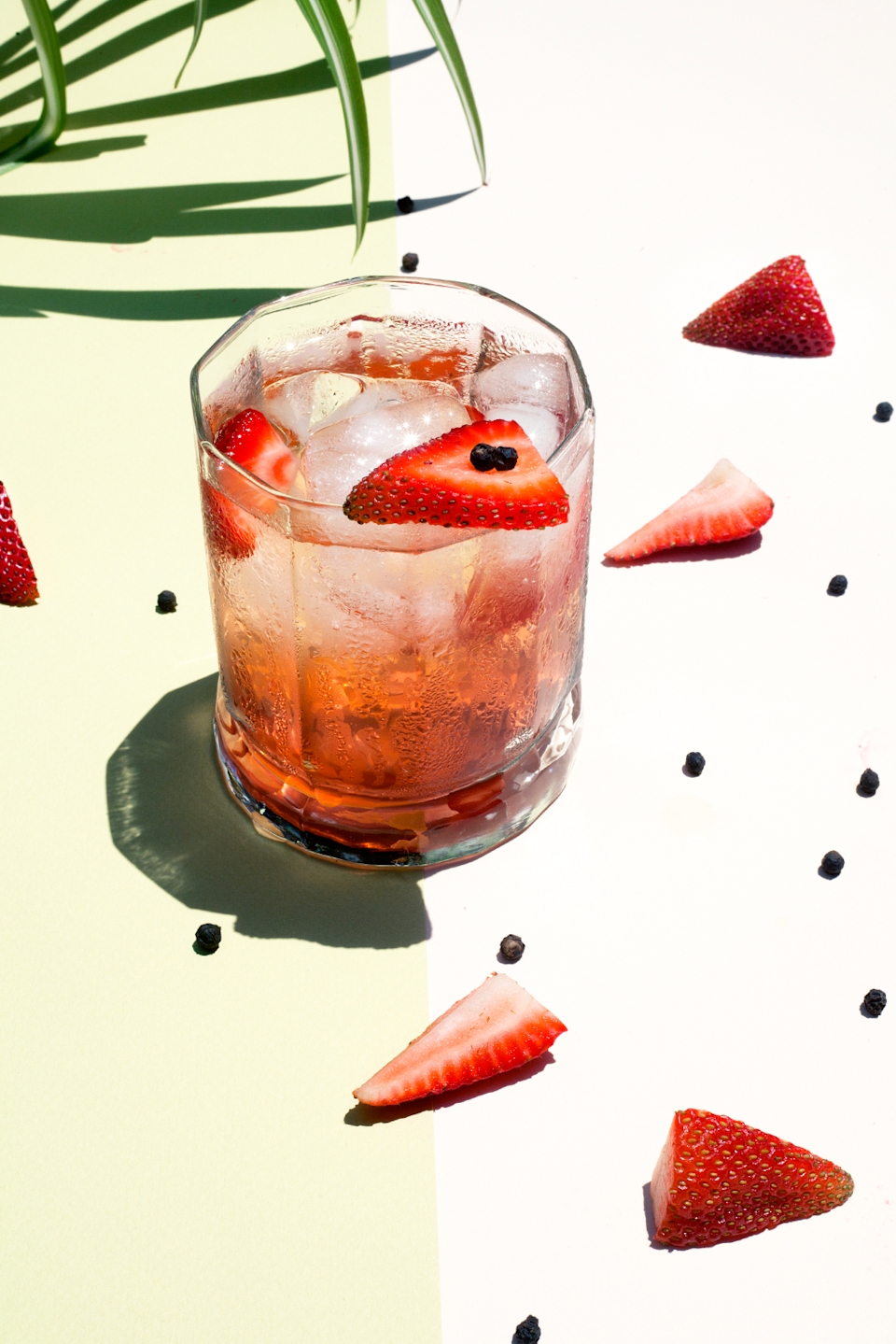 """<strong>Strawberry & Black Pepper</strong><br><br>An ideal combination for a hot summer's day, make the most of British strawberries while they are in season. The hint of black pepper adds an element of spice, and compliments the fruity sweetness.<br><br>The flavour of strawberry is best paired with the citrus and floral notes of <a href=""""http://www.waitrose.com/shop/ProductView-10317--115845-Bloom+London+Gin"""" rel=""""nofollow noopener"""" target=""""_blank"""" data-ylk=""""slk:Bloom premium London dry gin"""" class=""""link rapid-noclick-resp"""">Bloom premium London dry gin</a>. Bloom is made in Britain's oldest distillery (est. 1791), headed up by Master Distiller, Joanne Moore.<br><br><strong>Ingredients (Makes 1)</strong><br>50ml gin<br>4 strawberries<br>Black peppercorn grinder<br>Tonic water<br>Ice<br><br><strong>Method</strong><br>Muddle three of the strawberries with four twists of black pepper in the base of your glass. Fill with ice, stir and add the gin. Top with tonic, and garnish with sliced strawberry.<span class=""""copyright"""">Photographed by <strong>Roxana Azar</strong></span>"""