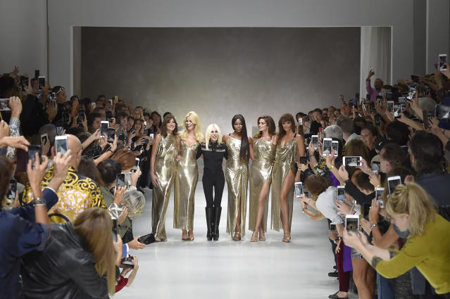 From left: Carla Bruni, Claudia Schiffer, Versace creative director Donatella Versace, Naomi Campbell, Cindy Crawford, and Helena Christensen during the finale of the Versace Spring/Summer 2018 show in September 2017. (Photo: Catwalking/Getty Images)