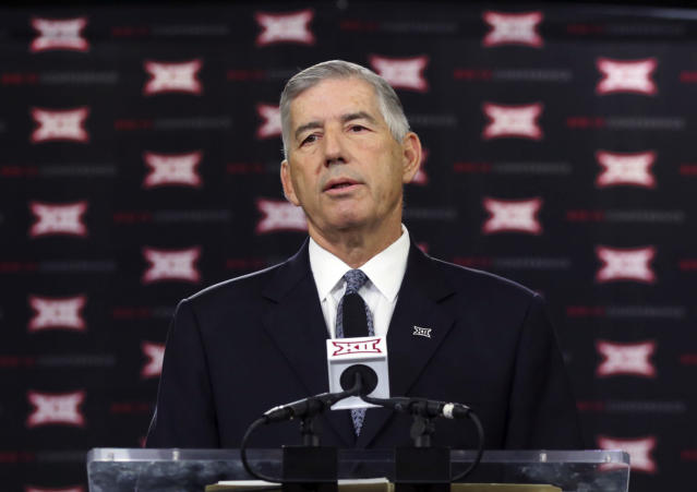 FILE - In this July 17, 2017, file photo, Big 12 commissioner Bob Bowlsby speaks to reporters during the Big 12 NCAA college football media day at the Dallas Cowboys' practice facilities in Frisco, Texas. The NCAA is about two weeks away from finally making some substantial reforms to transfer rules. The changes will not be quite as extensive as some had hoped and the work is not complete, but considering previous failed attempts, getting anything accomplished on transfers can be counted as a success. We aren't going to get as far down the path on transfers as I think most people hoped we would, Bowlsby said this week during the conferences meetings in Dallas. (AP Photo/LM Otero, File)
