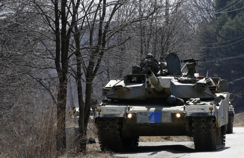 """South Korea's K-1 tanks take part in their military exercise in the border city between two Koreas, Paju, north of Seoul, South Korea, Friday, March 29, 2013. North Korean leader Kim Jong Un warned Friday that his rocket forces were ready """"to settle accounts with the U.S.,"""" unleashing a new round of bellicose rhetoric after U.S. nuclear-capable B-2 bombers dropped dummy munitions in joint military drills with South Korea. (AP Photo/Lee Jin-man)"""