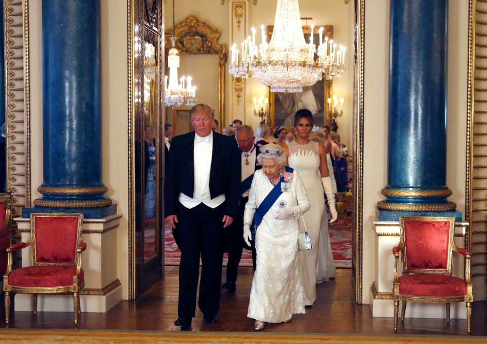 Britain's Queen Elizabeth II (2R), US President Donald Trump (L), US First Lady Melania Trump (R) arrive in the Music room to pose for a photograph, ahead of a State Banquet in the ballroom, at Buckingham Palace in central London on June 3, 2019, on the first day of the US president and First Lady's three-day State Visit to the UK. - Britain rolled out the red carpet for US President Donald Trump on June 3 as he arrived in Britain for a state visit already overshadowed by his outspoken remarks on Brexit. (Photo by Alastair Grant / POOL / AFP)        (Photo credit should read ALASTAIR GRANT/AFP/Getty Images)