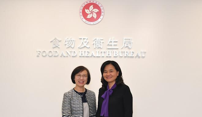 Hong Kong health minister Sophia Chan (left) greets Party Group Member of the National Health Commission Yu Yanhong. Photo: Handout
