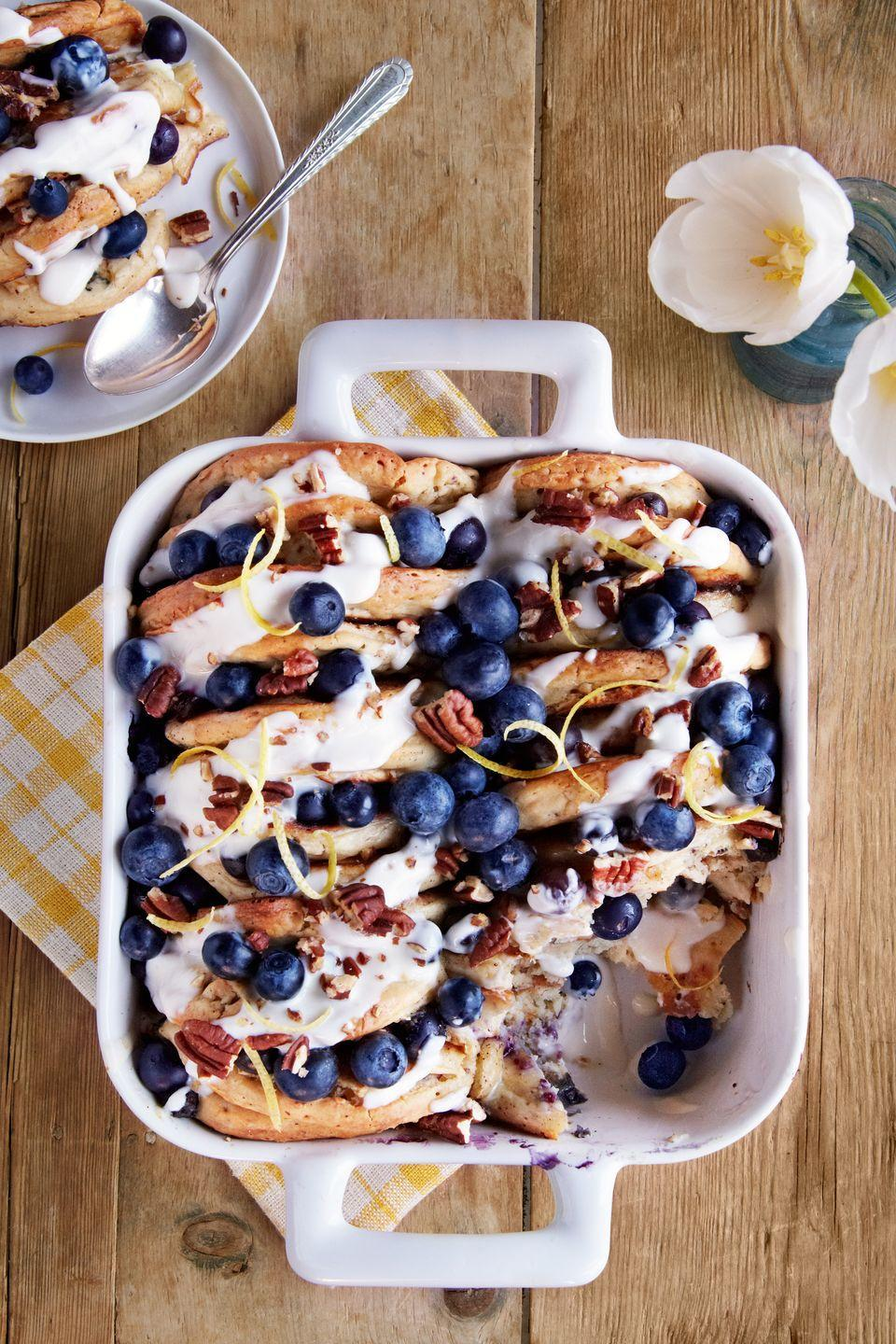 "Bread pudding and pancakes at the same time? Yes, it's as amazing as it sounds. <a href=""https://www.countryliving.com/food-drinks/recipes/a37601/blueberry-pecan-pancake-bread-pudding/"" rel=""nofollow noopener"" target=""_blank"" data-ylk=""slk:Get the recipe."" class=""link rapid-noclick-resp""><strong>Get the recipe.</strong></a>"