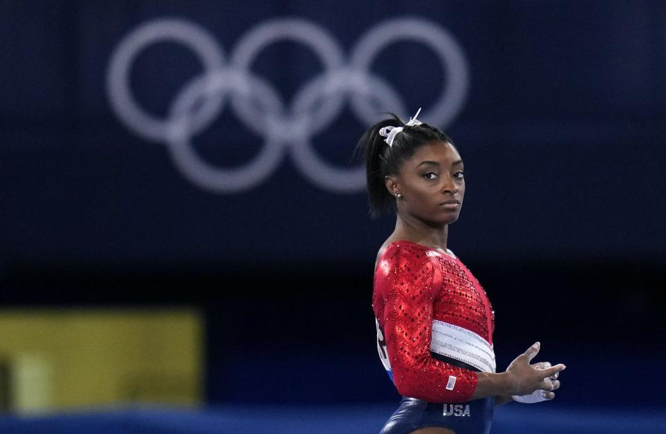 """<span class=""""caption"""">Simone Biles' sponsors, including Athleta and Visa, are lauding her decision to put her mental health first and withdraw from the gymnastics team competition during the Olympics. It's the latest example of sponsors praising athletes who are increasingly open about mental health issues. </span> <span class=""""attribution""""><span class=""""source"""">(AP Photo/Gregory Bull, File)</span></span>"""