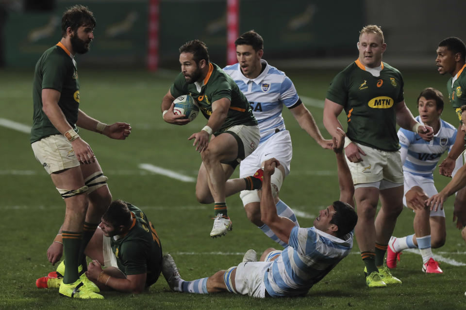 Cobus Reinach of South Africa jumps over Guido Petti of Argentina during the first Rugby Championship match between South Africa's Springboks and Argentina at the Nelson Mandela Stadium, in Gqeberha, South Africa, Saturday, Aug. 14, 2021. (AP Photo/Halden Krog)