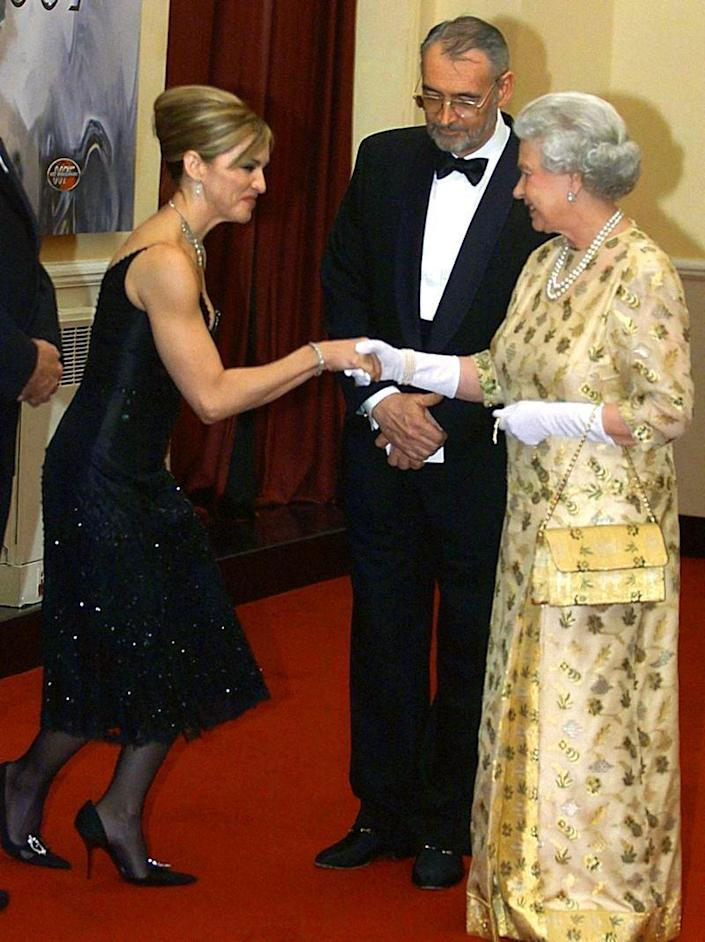 <p>This is what it looks like when the Queen of Pop meets the Queen of England at the premiere of <em>Die Another Day</em>. Also, please note Madonna's killer arms. </p>