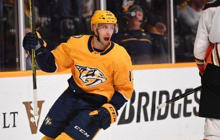 Nov 25, 2018; Nashville, TN, USA; Nashville Predators center Nick Bonino (13) celebrates after a goal by Nashville Predators right wing Craig Smith (not pictured) during the third period against the Anaheim Ducks at Bridgestone Arena. Mandatory Credit: Christopher Hanewinckel-USA TODAY Sports