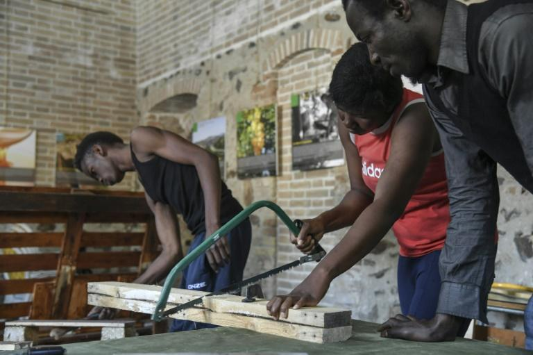Migrants from African countries attend a lesson of carpentry in Sant' Alessio in Aspromonte, a small village of 330 inhabitants in Calabria, southern Italy