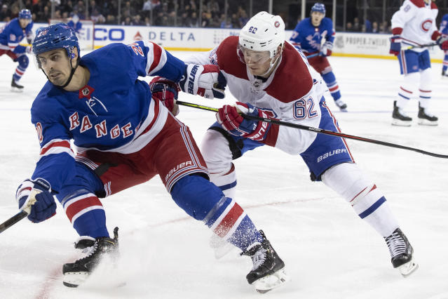 New York Rangers left wing Chris Kreider (20) skates against Montreal Canadiens left wing Artturi Lehkonen (62) during the second period of an NHL hockey game Friday, Dec. 6, 2019, at Madison Square Garden in New York. (AP Photo/Mary Altaffer)