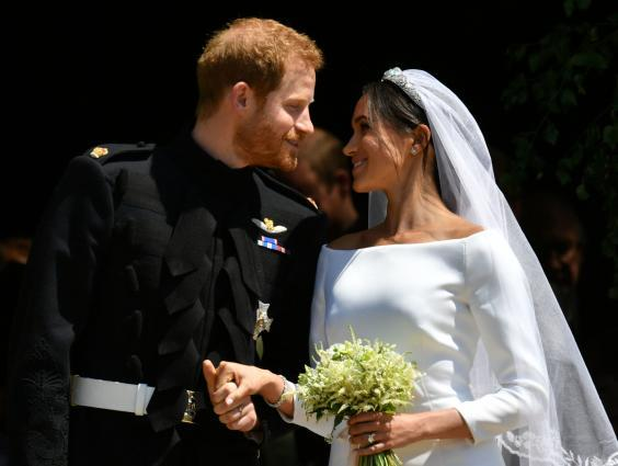 From rags to riches: Prince Harry and Meghan Markle romanticise the American dream of meeting a charming and rich man (AFP/Getty)