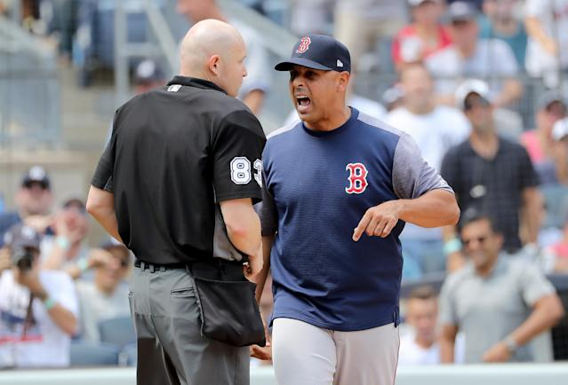 Red Sox manager Alex Cora argues with home plate umpire Mike Estabrook on Saturday. (Getty)