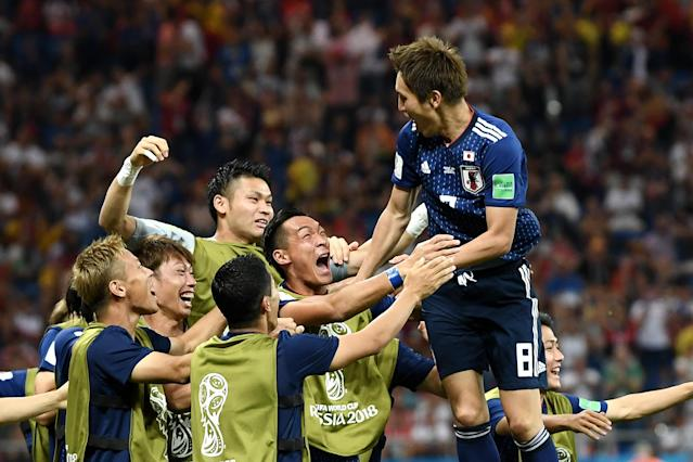 <p>Genki Haraguchi of Japan celebrates with teammates after scoring his team's first goal during the 2018 FIFA World Cup Russia Round of 16 match between Belgium and Japan at Rostov Arena on July 2, 2018 in Rostov-on-Don, Russia. (Photo by Carl Court/Getty Images) </p>
