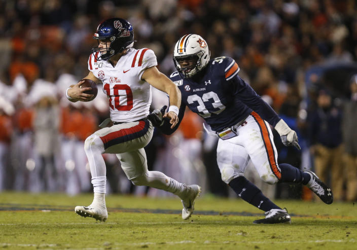 Mississippi quarterback John Rhys Plumlee (10) carries the ball as Auburn linebacker K.J. Britt (33) closes in for the tackle during the first half of an NCAA college football game Saturday, Nov. 2, 2019, in Auburn, Ala. (AP Photo/Butch Dill)