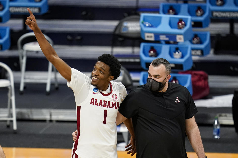 Alabama forward Herbert Jones (1) waves to fans as he leaves the court following a first-round win. (AP Photo/Michael Conroy)