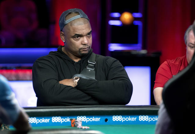 "Richard Seymour, former <a class=""link rapid-noclick-resp"" href=""/nfl/teams/new-england/"" data-ylk=""slk:Patriots"">Patriots</a> defensive end, competes at a featured table during the World Series of Poker main event at the Rio hotel-casino in Las Vegas Wednesday, July 10, 2019. (Steve Marcus/Las Vegas Sun via AP)"