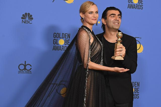 Diane Kruger and director Fatih Akin in the press room after winning theGolden Globe award for Best Motion Picture — Foreign Language for <em>In the Fade.</em>(Photo: Kevin Winter/Getty Images)
