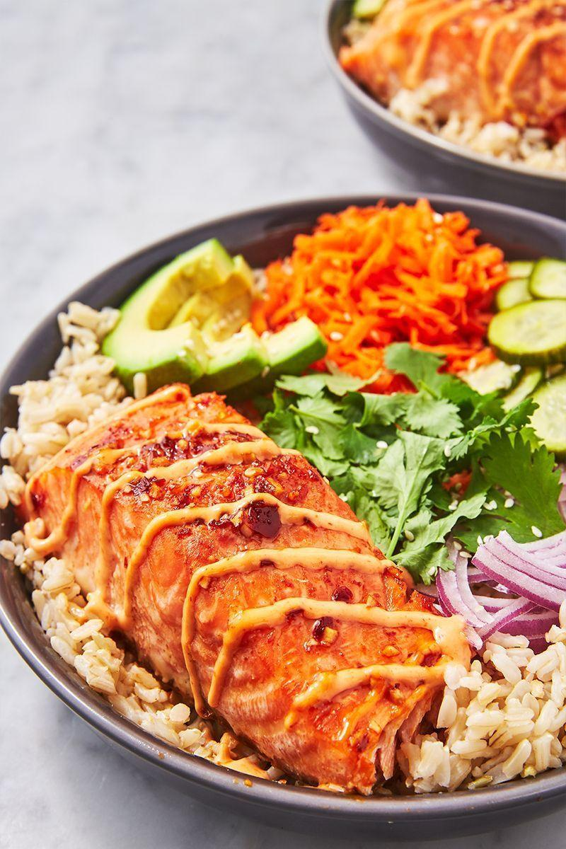"<p>There is something magical about grain bowls. They are perfect for meal prepping and packing up for lunches. All of the components are great on their own, and once they're tossed together, they somehow become even better. This spicy salmon bowl has all of our favourite things, and is by far our favourite bowl to date. </p><p>Get the <a href=""https://www.delish.com/uk/cooking/recipes/a29843921/spicy-salmon-bowl-recipe/"" rel=""nofollow noopener"" target=""_blank"" data-ylk=""slk:Spicy Salmon Bowl"" class=""link rapid-noclick-resp"">Spicy Salmon Bowl</a> recipe. </p>"