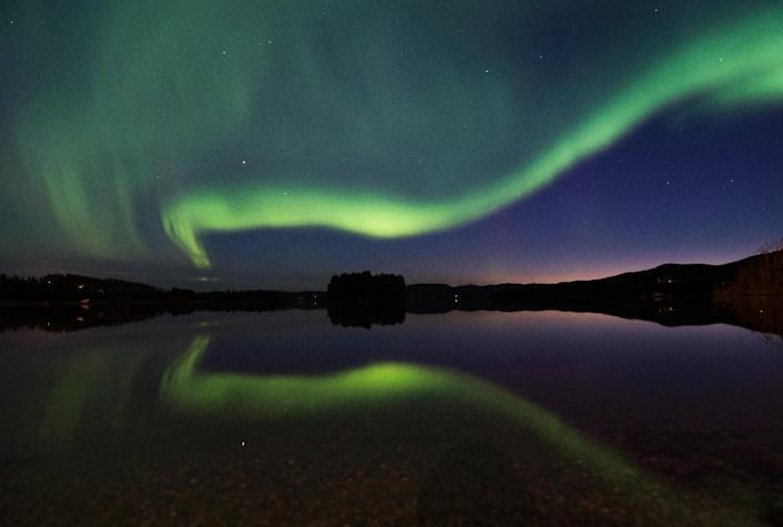 The Northern Lights have helped draw tourists to the Arctic (AFP Photo/JONATHAN NACKSTRAND)