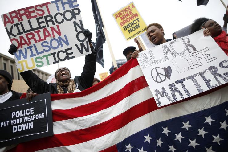 Protesters gather for the start of a rally in St. Louis, Missouri, October 11, 2014. (REUTERS/Jim Young) Click photo for slideshow of protests in Ferguson
