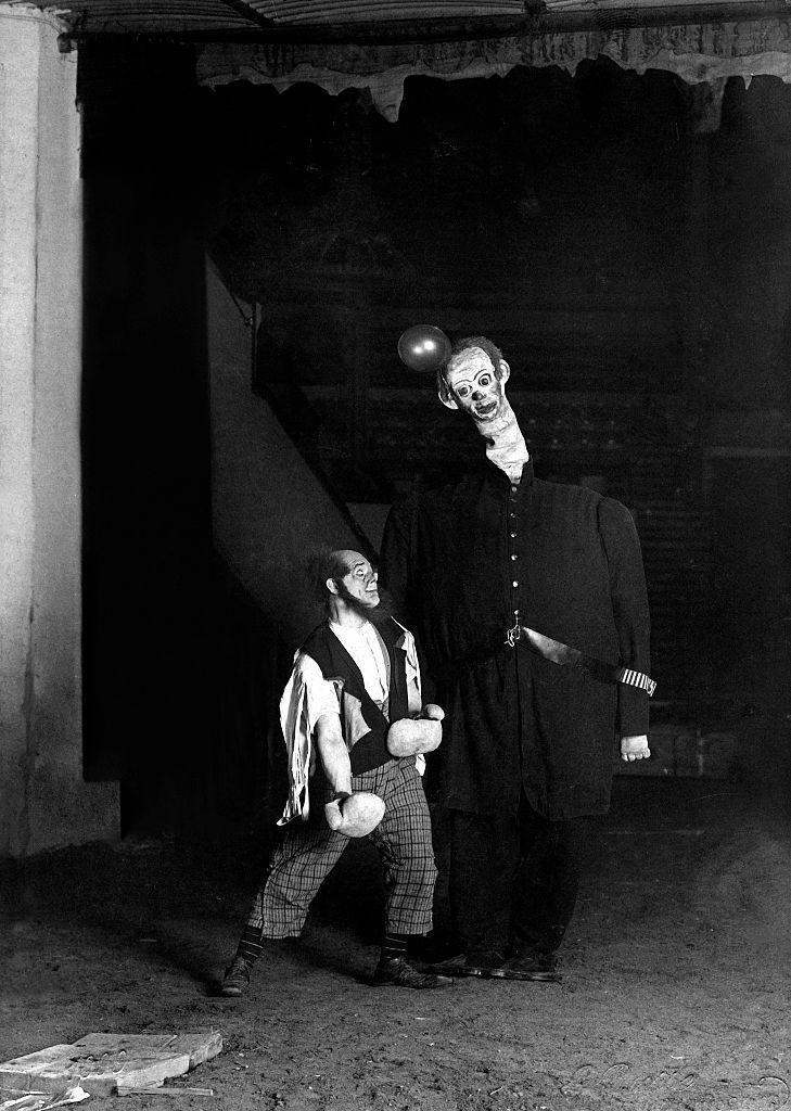 """<p>Two circus clowns stand next to each other during a German performance. According to Heathline, <a href=""""https://www.healthline.com/health/mental-health/fear-of-clowns"""" rel=""""nofollow noopener"""" target=""""_blank"""" data-ylk=""""slk:nearly eight percent of Americans"""" class=""""link rapid-noclick-resp"""">nearly eight percent of Americans</a> struggle with coulrophobia: the fear of clowns.</p>"""
