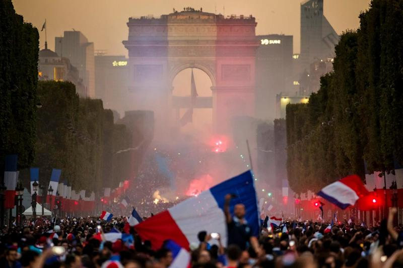 Supporters celebrate on the Champs-Elysees after France's 4-2 win (EPA)