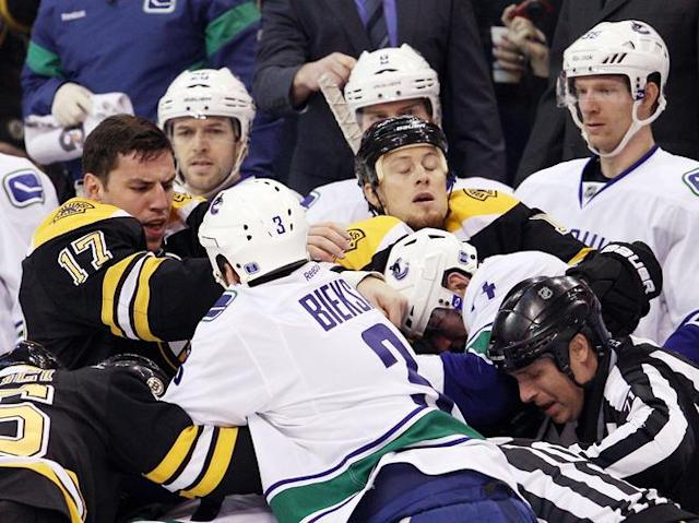BOSTON, MA - JANUARY 07: Milan Lucic #17 of the Boston Bruins fights with Kevin Bieksa #3 of the Vancouver Canucks in the first period on January 7, 2012 at TD Garden in Boston, Massachusetts. (Photo by Elsa/Getty Images)