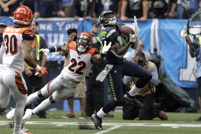 Seattle Seahawks wide receiver DK Metcalf right, makes a catch over Cincinnati Bengals cornerback William Jackson (22) during the first half of an NFL football game Sunday, Sept. 8, 2019, in Seattle. (AP Photo/Stephen Brashear)