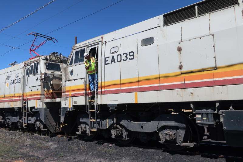 This Aug. 20, 2019, image shows train operator Ron Little preparing for one of the last trips to pick up coal from the Kayenta Mine to fuel the Navajo Generating Station near Page, Ariz. The power plant will close before the year ends, upending the lives of hundreds of mostly Native American workers who mined coal, loaded it and played a part in producing electricity that powered the American Southwest. (AP Photo/Felicia Fonseca)