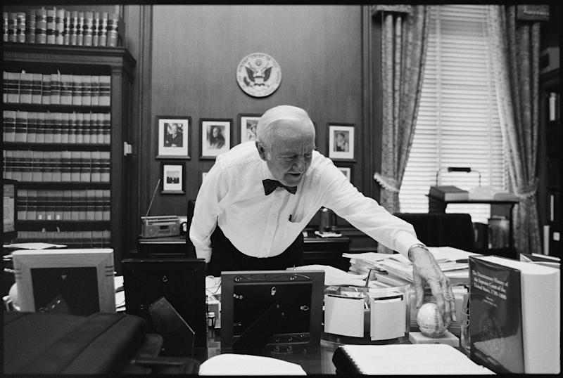 Justice John Paul Stevens works in his chambers at the Supreme Court on June 17, 2002, in Washington.