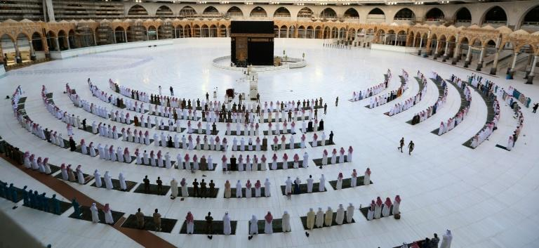 Worshippers observe social distancing as they gather for Eid al-Fitr holiday prayers at the Grand Mosque in the holy Saudi city of Mecca