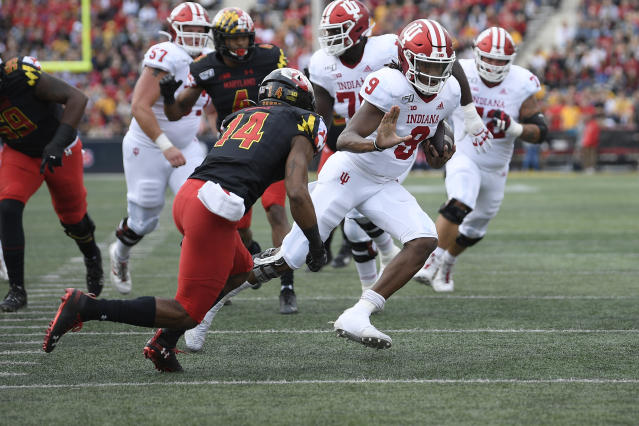 Indiana quarterback Michael Penix Jr. (9) scrambles with the ball against Maryland defensive back Deon Jones (14) during the first half of an NCAA college football game, Saturday, Oct. 19, 2019, in College Park, Md. (AP Photo/Nick Wass)