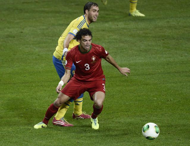 Portugal's Pepe controls the ball in front of Sweden's Johan Elmander during the World Cup 2014 qualifying playoff second leg soccer match between Sweden and Portugal at Friends Arena in Stockholm, Tuesday, Nov. 19, 2013. (AP/Pontus Lundahl, TT) SWEDEN OUT
