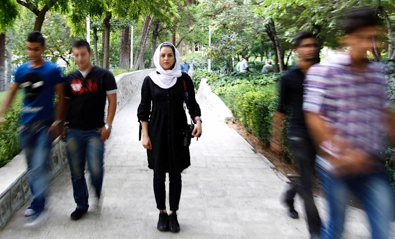 Iranian photographer Newsha Tavakolian poses for a picture in a park in Tehran, June 26, 2011