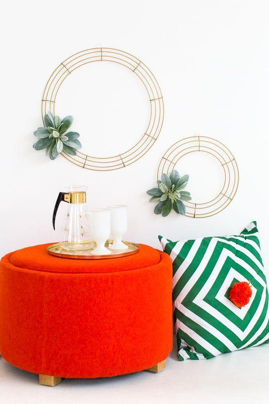 "<p>Swap out accent pieces for things in festive colors, like a red ottoman or chair. Add a green throw pillow and you're set.</p><p>See more at <a href=""https://sugarandcloth.com/simple-diy-geometric-wreath/"" rel=""nofollow noopener"" target=""_blank"" data-ylk=""slk:Sugar & Cloth"" class=""link rapid-noclick-resp"">Sugar & Cloth</a>.</p>"
