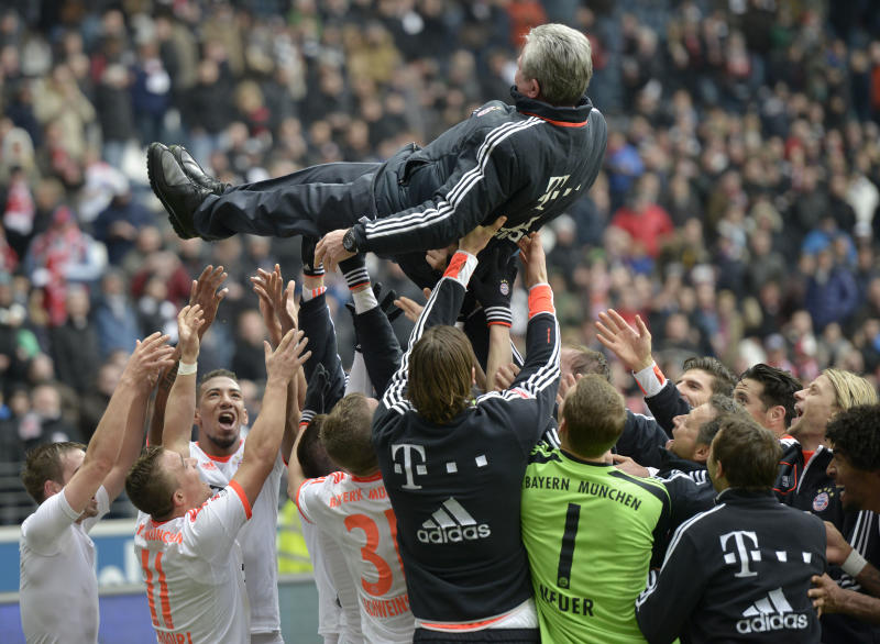 Bayern head coach Jupp Heynckes is celebrated by his team after the German first division Bundesliga soccer match between Eintracht Frankfurt and Bayern Munich in Frankfurt, Germany, Saturday, April 6, 2013. Bayern Munich wrapped up the German title in record time by winning 1-0 at Eintracht Frankfurt on Saturday with six rounds left in the season, an unprecedented feat in 50 years of the Bundesliga.(AP Photo/Martin Meissner)