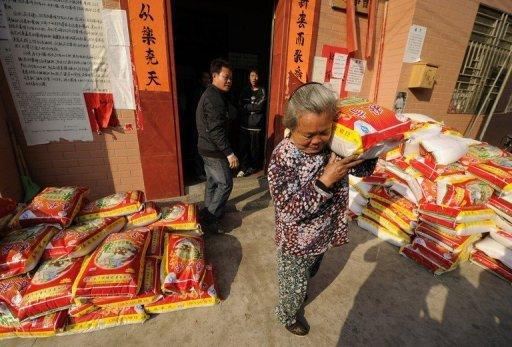 A resident collects a bag of rice from the provisional village commitee in Wukan, a fishing village in the southern province of Guangdong, southern China. Protesters from the village say they will march on government offices this week unless the body of a local leader is released and four villagers in police custody are freed
