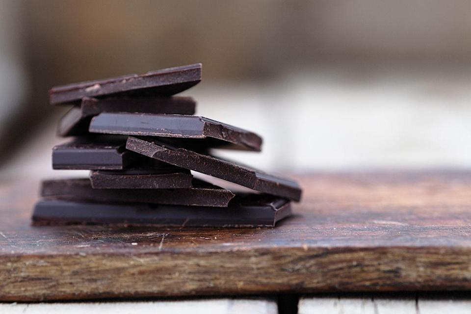 """<p>Chocolate may not be the first thing you think of when it comes to better nutrition after 40, but this after-dinner indulgence can actually do wonders for your health. """"Dark chocolate is rich in flavonols, which protect your heart, reduce the risk of diabetes, and <a href=""""https://www.prevention.com/health/health-conditions/g26576559/foods-for-high-blood-pressure/"""" rel=""""nofollow noopener"""" target=""""_blank"""" data-ylk=""""slk:lower blood pressure"""" class=""""link rapid-noclick-resp"""">lower blood pressure</a>, """" Mirkin says. Stick to chocolate bars that contain at least 70% cocoa and less than 6 grams of added sugar to get the most nutritional bang out of every serving. </p><p><strong>Try it: </strong><a href=""""https://www.prevention.com/food-nutrition/healthy-eating/g25728973/healthy-chocolate-bars-snacks/"""" rel=""""nofollow noopener"""" target=""""_blank"""" data-ylk=""""slk:13 Healthy Dark Chocolate Bars That Aren't Sugar Bombs"""" class=""""link rapid-noclick-resp"""">13 Healthy Dark Chocolate Bars That Aren't Sugar Bombs</a></p>"""