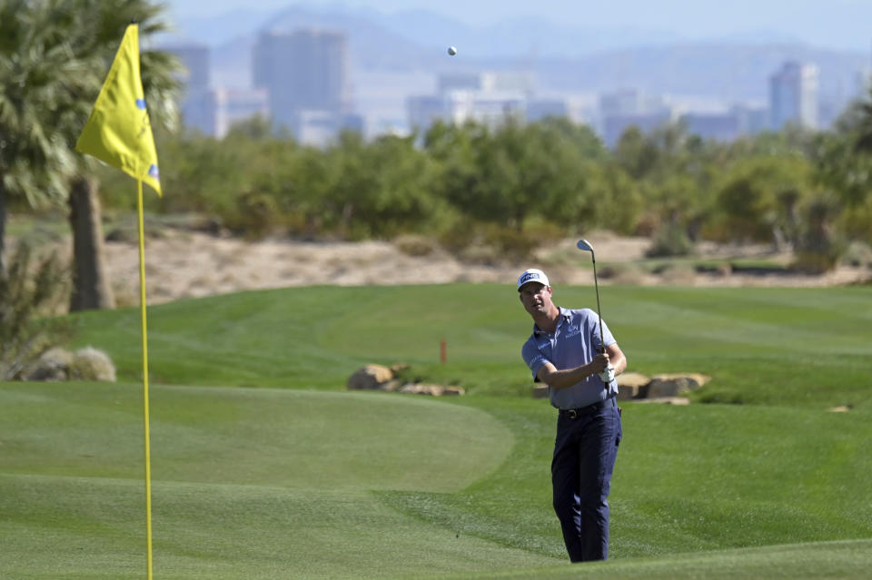 Harris English takes his third shot on the 13th hole during first round of the CJ Cup golf tournament Thursday, Oct. 14, 2021, in Las Vegas. (AP Photo/David Becker)