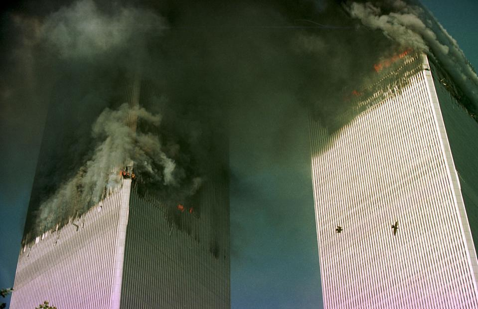 <p>The World Trade Center is engulfed in flames just before the south tower collapsed. (Getty)</p>