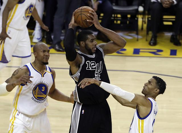 <p>San Antonio Spurs' LaMarcus Aldridge (12) is defended by Golden State Warriors' Patrick McCaw, right, and David West (3) during the first half of Game 2 of the NBA basketball Western Conference finals, Tuesday, May 16, 2017, in Oakland, Calif. (AP Photo/Marcio Jose Sanchez) </p>