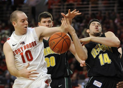 Stony Brook's Bryan Dougher (10) and Vermont's Josh Elbaum (14) battle for a rebound during the first half of the America East Men's Basketball Championship game on Saturday, March 10, 2012, in Stony Brook, NY. (AP Photo/Kathy Kmonicek)