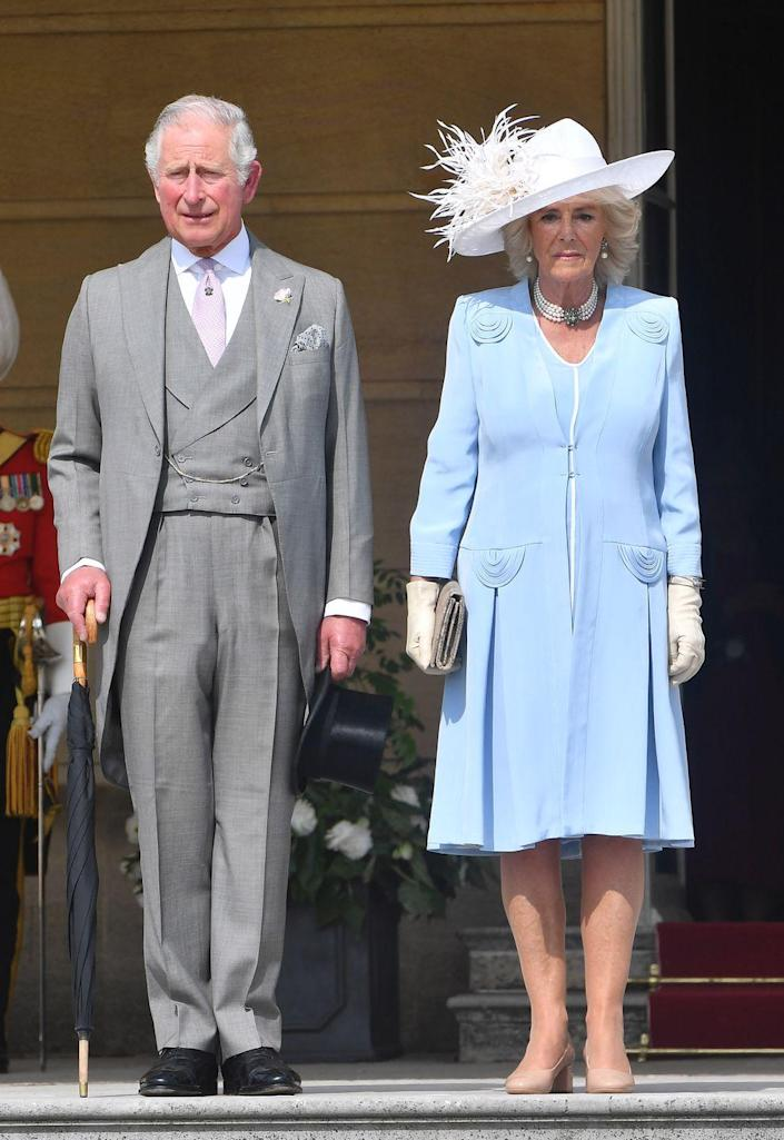 """<p>Camilla Parker Bowles wore a periwinkle coat dress and white feathered hat to the <a href=""""https://www.townandcountrymag.com/society/tradition/g21082698/buckingham-palace-garden-party-prince-charles-camilla-photos/"""" rel=""""nofollow noopener"""" target=""""_blank"""" data-ylk=""""slk:Buckingham Palace Garden Party."""" class=""""link rapid-noclick-resp"""">Buckingham Palace Garden Party.</a></p>"""