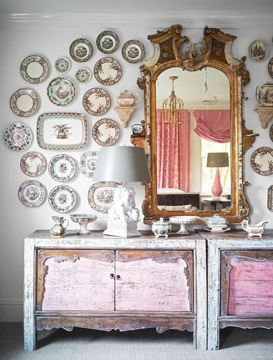 "<p>If you have an extensive China collection, why not put it up for all to see? It's an unexpected twist to the classic gallery wall look, too, as you can see in this blush pink living room designed by <a href=""https://janiemolster.com/"" rel=""nofollow noopener"" target=""_blank"" data-ylk=""slk:Janie Molster"" class=""link rapid-noclick-resp"">Janie Molster</a>. Once you've mapped out the gallery wall, all you need are some picture hangers. <a href=""https://www.housebeautiful.com/design-inspiration/a29652925/how-to-hang-plates-on-wall/"" rel=""nofollow noopener"" target=""_blank"" data-ylk=""slk:Get a tutorial here."" class=""link rapid-noclick-resp"">Get a tutorial here. </a></p>"