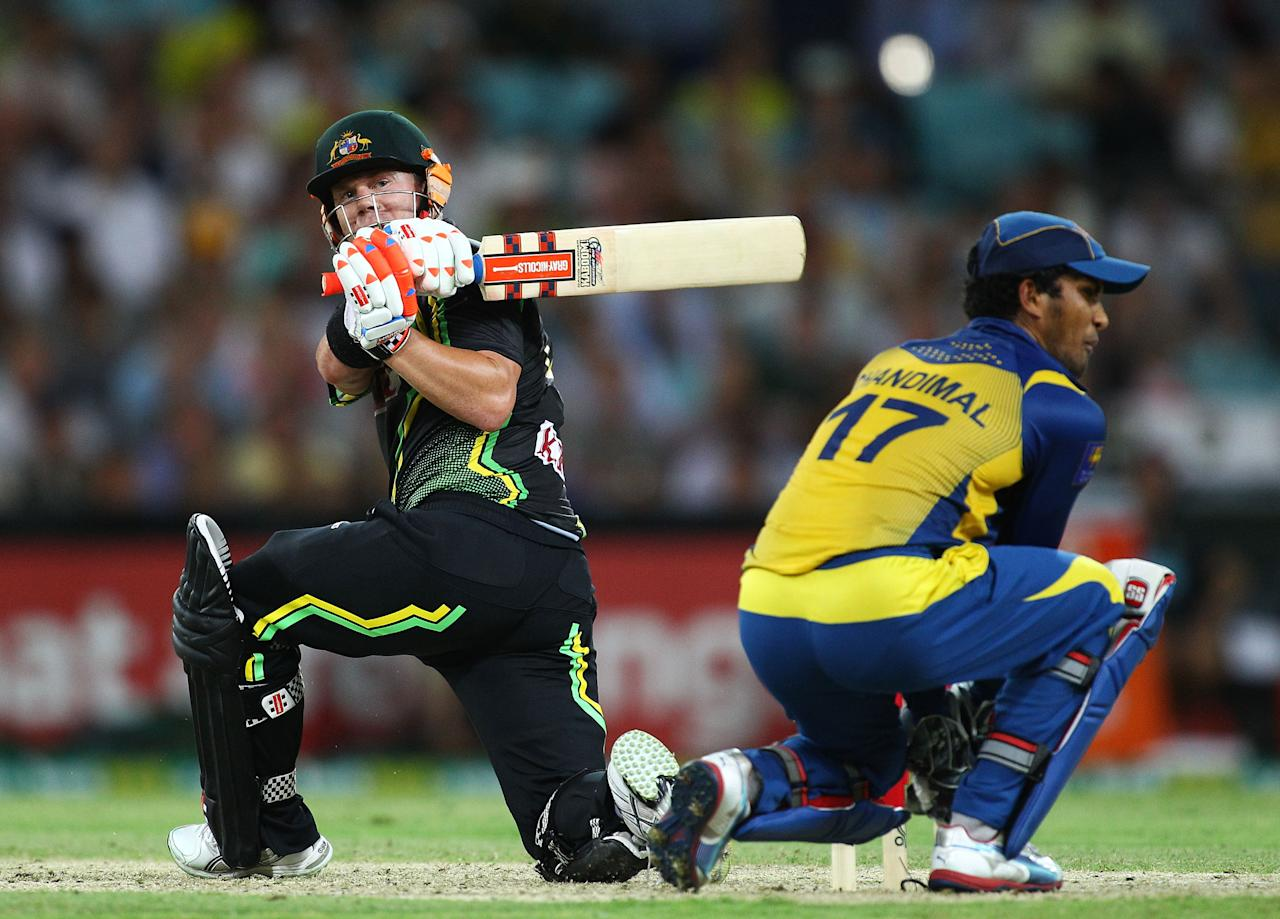 SYDNEY, AUSTRALIA - JANUARY 26:  Dave Warner of Australia attempts a reverse sweep during game one of the Twenty20 international match between Australia and Sri Lanka at ANZ Stadium on January 26, 2013 in Sydney, Australia.  (Photo by Don Arnold/Getty Images)