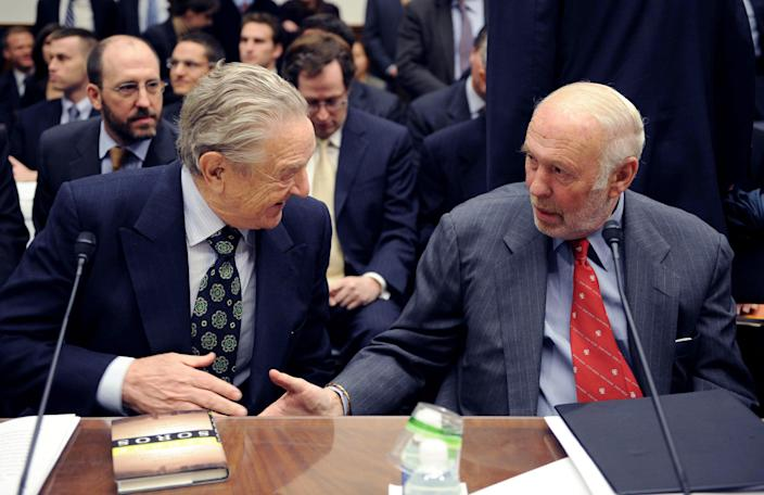 Soros Fund Management chairman George Soros, left, shakes hands with Renaissance Technologies then-president James Simons on Capitol Hill in 2008, prior to a committee hearing on hedge funds. (Photo: Kevin Wolf/AP)