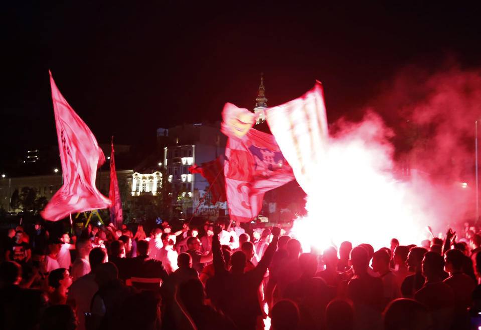 Red Star fans celebrate after their team won the Serbian soccer league title in Belgrade, Serbia, Saturday, May 22, 2021. (AP Photo/Darko Vojinovic)