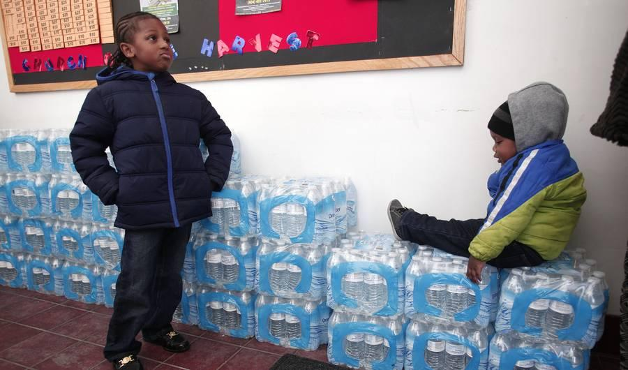 Children in Flint, Michigan, stock up on bottled water amid the city's lead poisoning crisis.