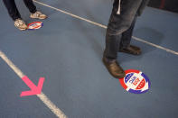 Voters stand six feet apart while waiting to car their ballot during early voting at the Park Slope Armory YMCA, Tuesday, Oct. 27, 2020, in the Brooklyn borough of New York. (AP Photo/Mary Altaffer)